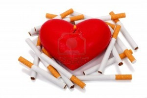 6588934-burning-candle-in-the-shape-of-the-heart-cigarettes-shorten-life-stop-smoking-concept